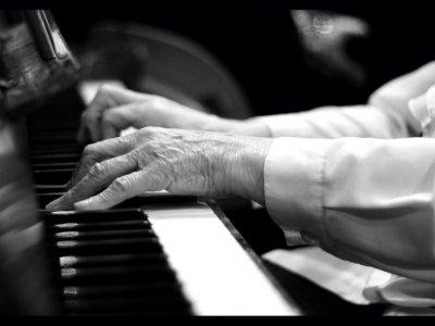 Elderly man's hands playing piano
