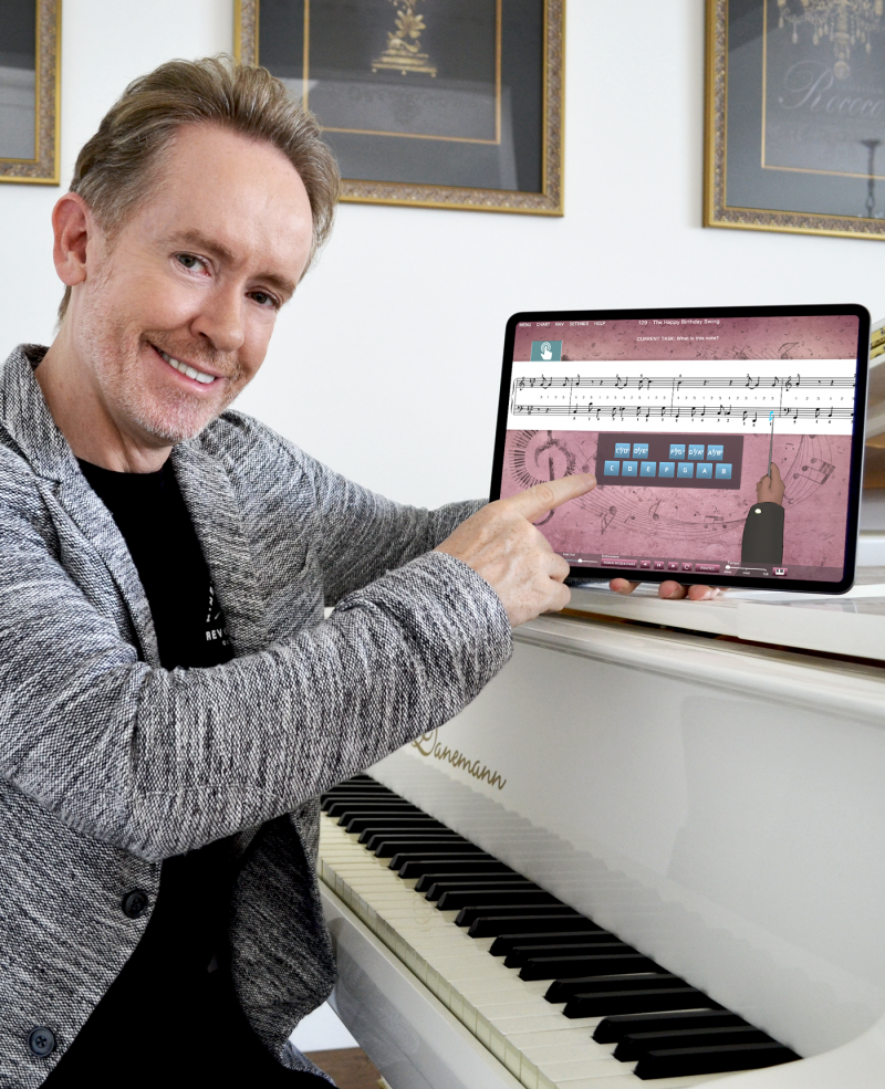 Musiah Inventor pictured with new iPad piano lessons app Musiah