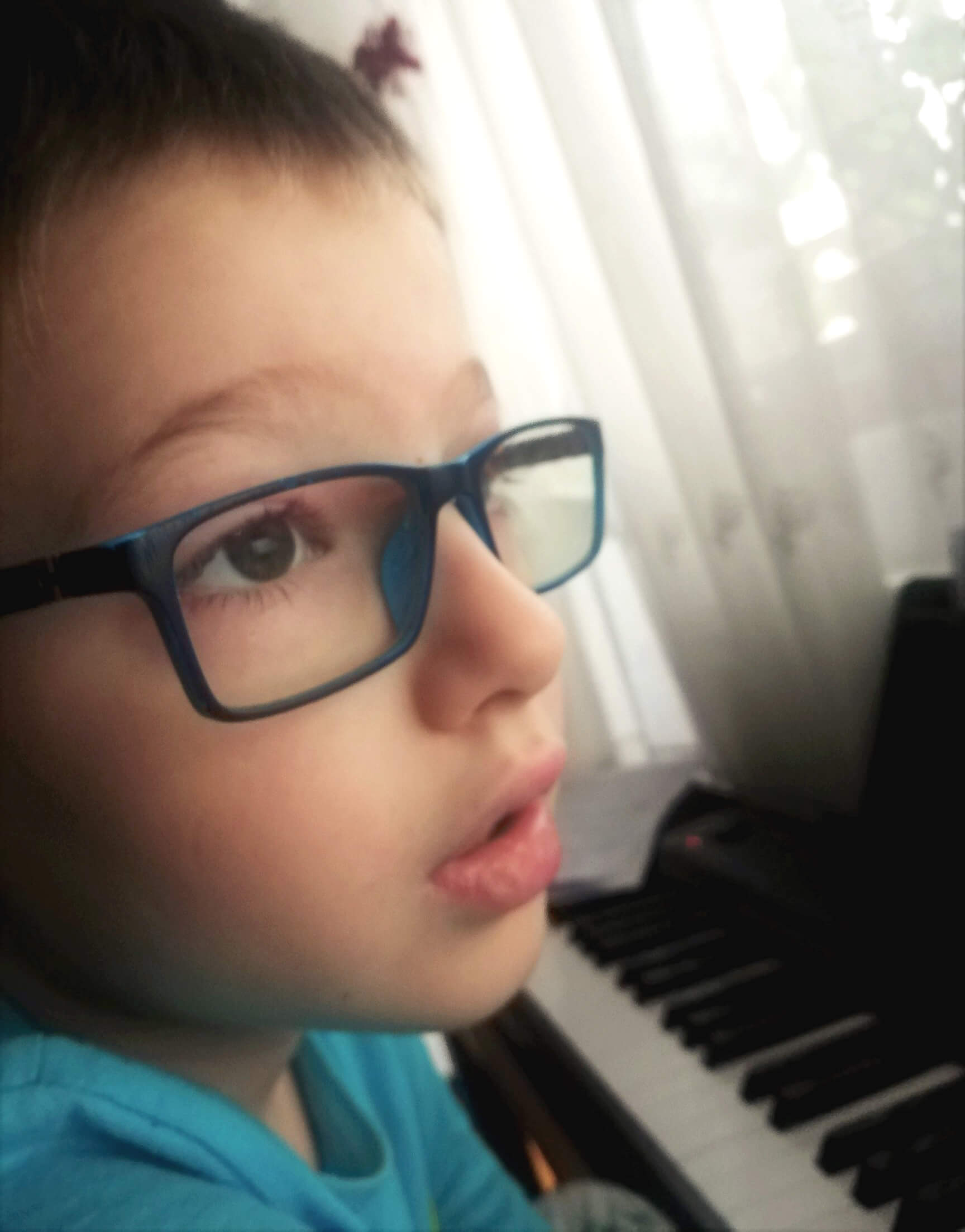 Young boy at piano